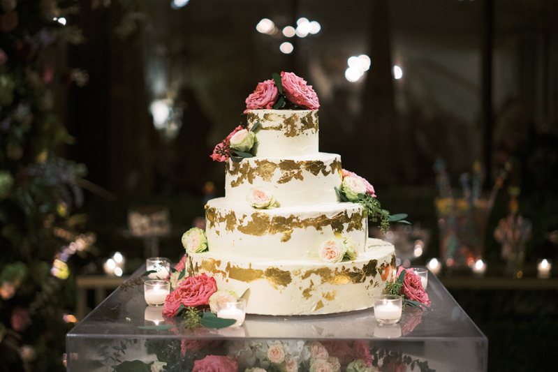 Four tiered wedding cake with gold foil