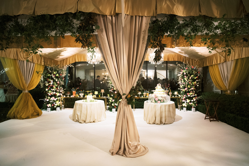 Taupe drapery at tented wedding reception in New Orleans