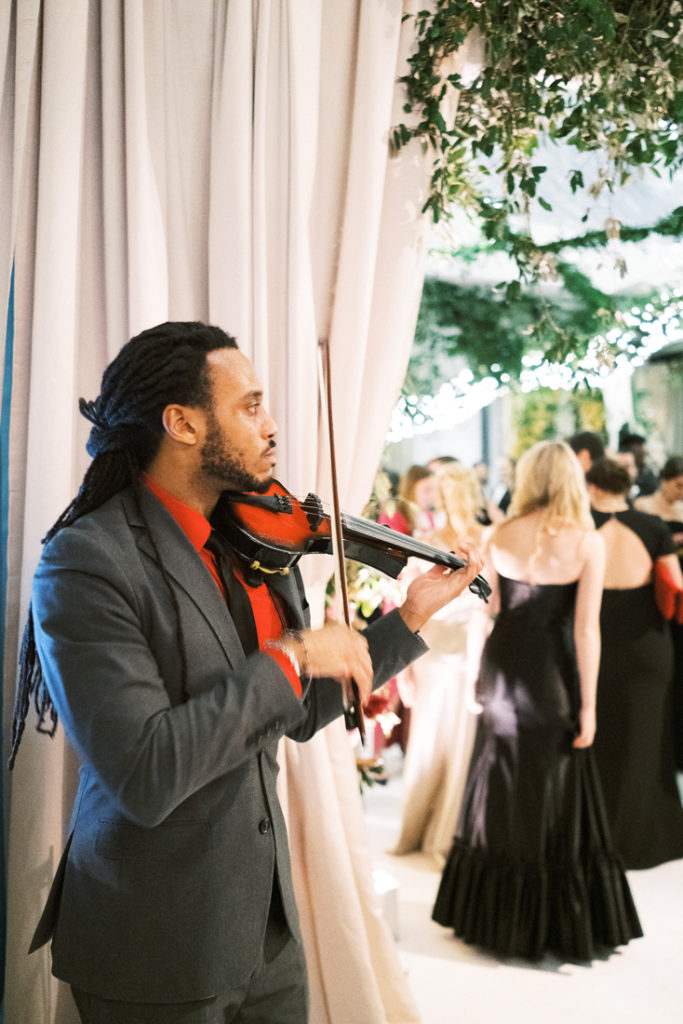 Violinist performing during cocktail hour at New Orleans wedding