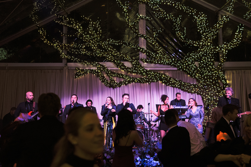 Powerhouse band and crowded dance floor during New Orleans wedding.