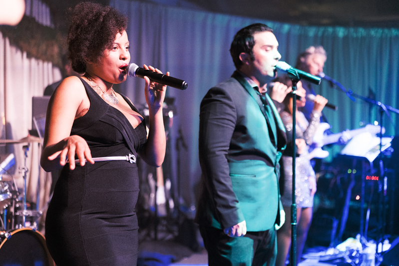 Powerhouse band vocalists performing on stage during Nola wedding reception.