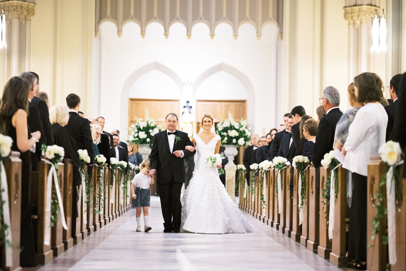 Bride escorted down aisle during Nola wedding