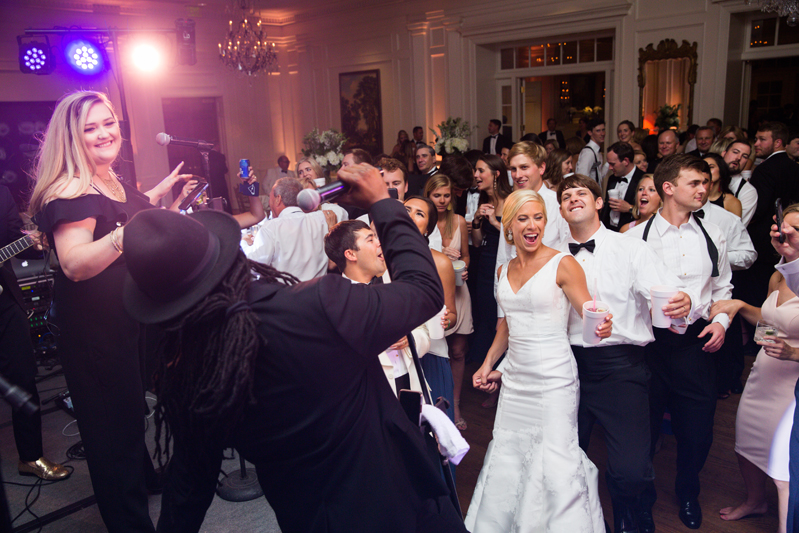 Bride and Groom dancing in front of Punch band at wedding.