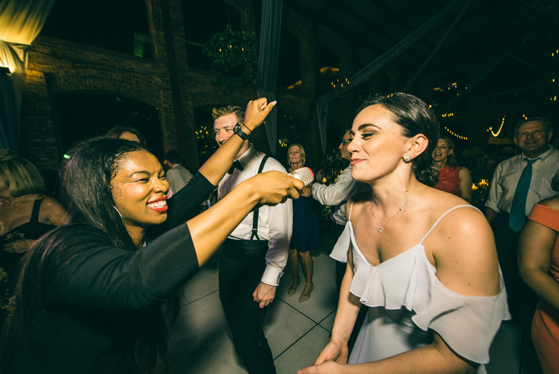 lead singer holding microphone to dancing bridesmaid