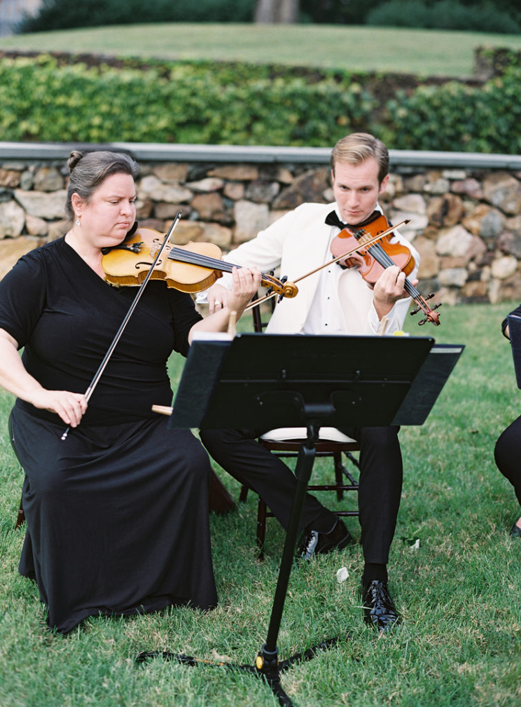 String quartet performing outside at Dover Hall wedding