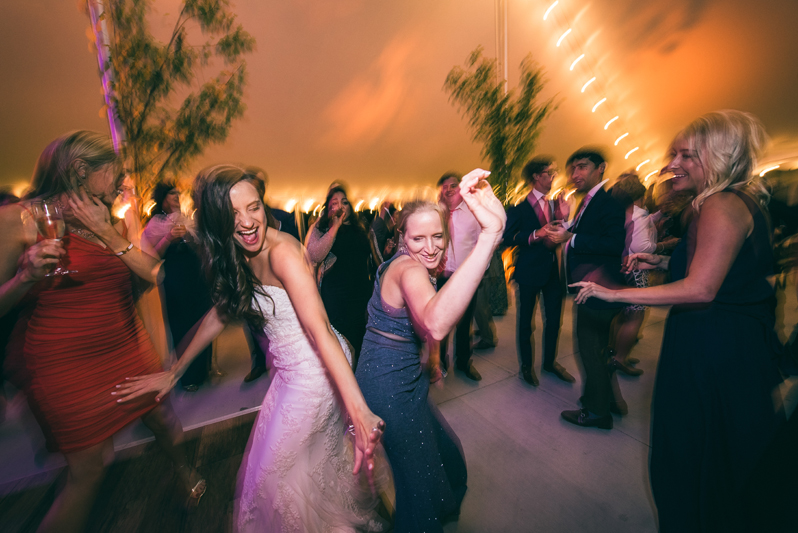 Bride and woman dancing at wedding reception at Summerfield Farms.