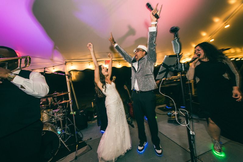 Bride on stage with Right to Party band at Summerfield Farms wedding.