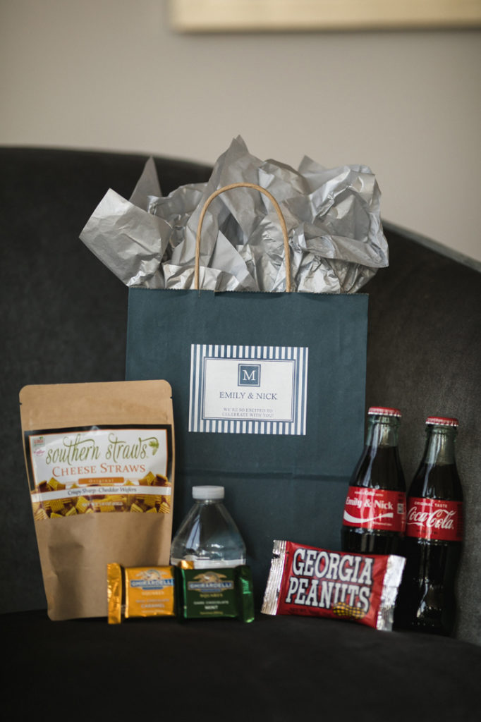 Wedding welcome gift bag with coca cola and snacks.