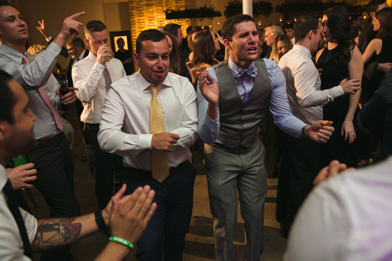 Male guests dancing during The Stave Room wedding.