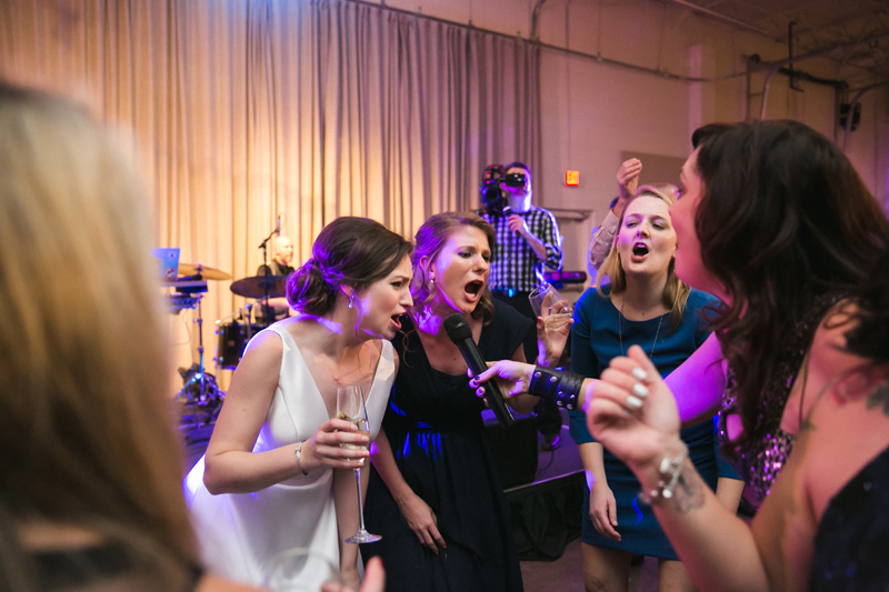Bride and wedding guests dancing on dance floor with We Got The Beat band.