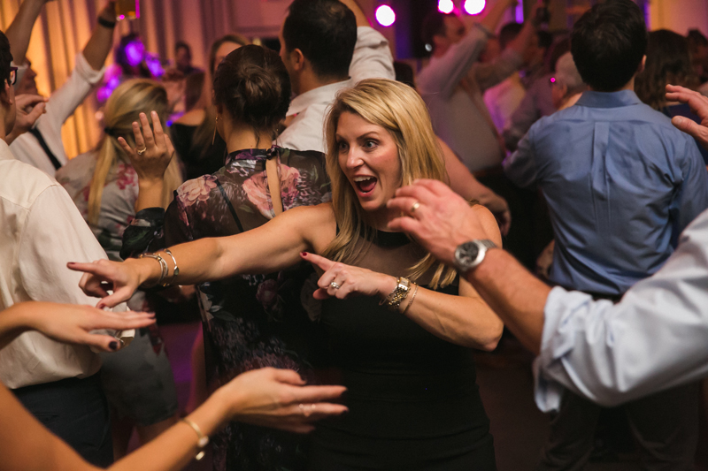 Guest dancing on crowded dance floor to We Got the Beat band.