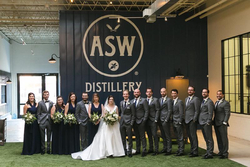 Bride, groom and wedding party as ASW Distillery wedding.