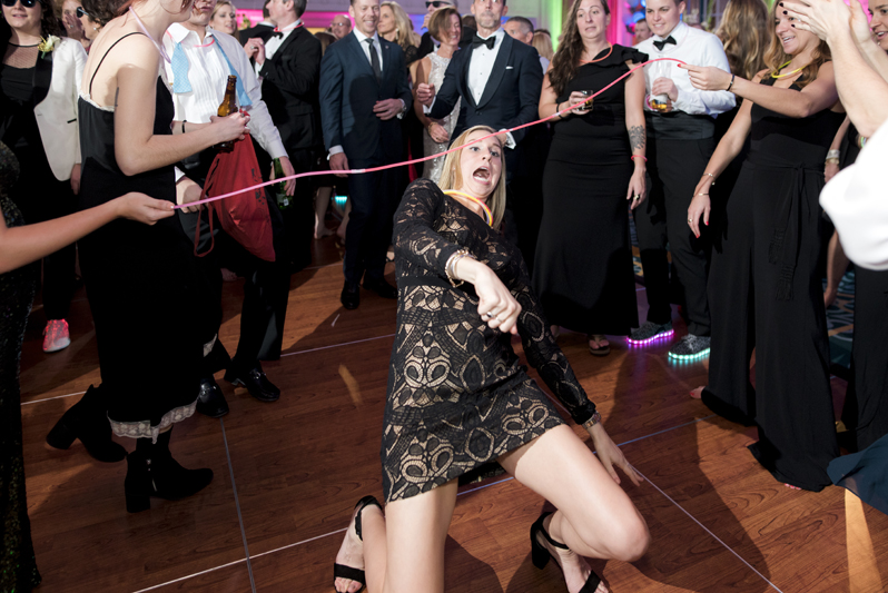 Female wedding guests doing the limbo during a wedding at The Jefferson Hotel