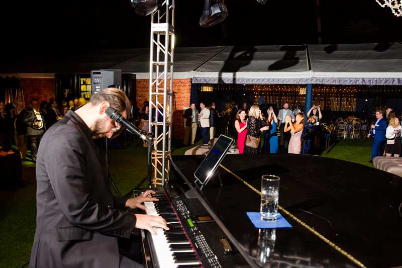 Dueling pianos performing at private corporate event.