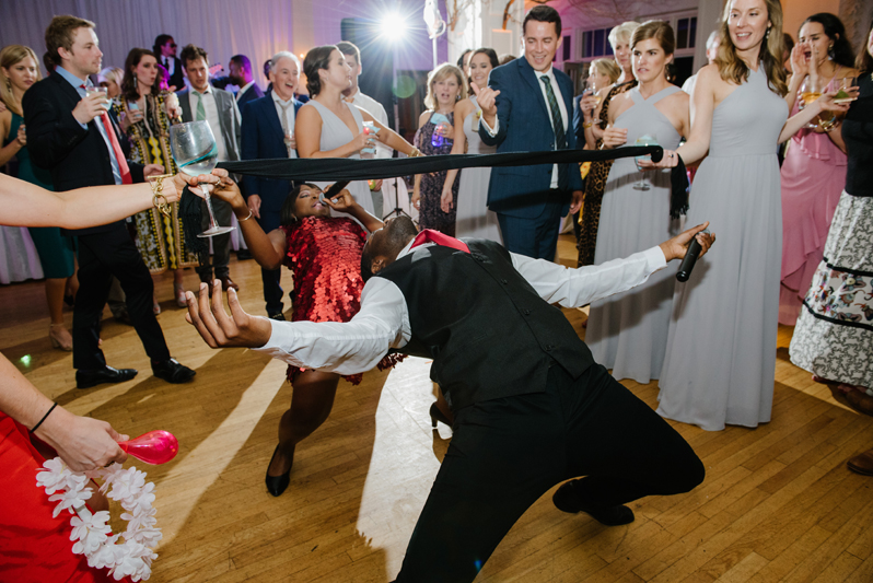 Guest on dance floor doing the limbo at Roaring Gap Club wedding.