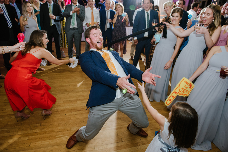 Wedding guest dancing during Roaring Gap Club wedding.