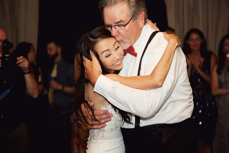 Father kissing daughter while dancing to Loose Chain wedding band.