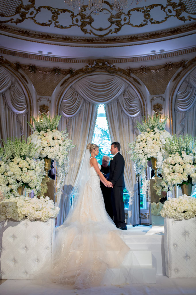 Bride and groom during ceremony at Palm Beach wedding.