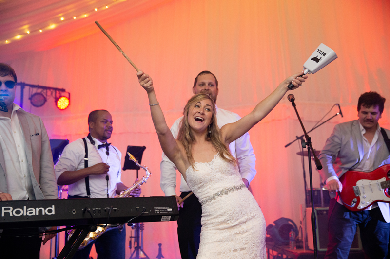 Bride on stage with Bantum Rooster band at Biltmore wedding reception.