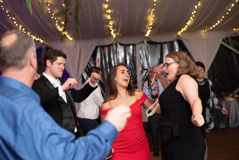 Guests dancing to Bantum Rooster band at Biltmore wedding reception.