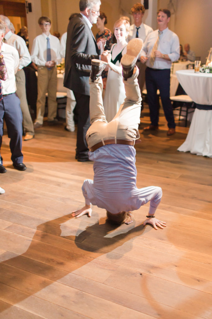 Guest breakdancing at Kiawah Island Club wedding reception.
