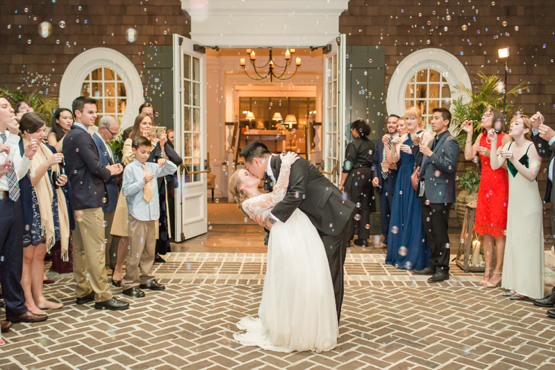 Bride and groom kissing as they make a grand exit from their Kiawah Island Club wedding.